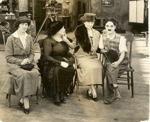 Polly Thompson, Anne Sullivan Macy, Helen Keller and Charlie Chaplin on the set of Shoulder Arms, 1918. AFB