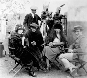 Adela Rogers St. Johns, L-R Colleen Moore, Sam Taylor, Harold Lloyd with Walter Lundin at the camera on set of Why Worry? (1923), signed (1972). PCRB