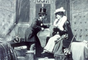 George Albert Smith and Laura Bayley (a/o) in The Kiss in the Tunnel (1899).