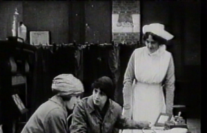 Letty Paxton (Mary) visits School for Mothers, Dorothea Baird (w/a/p) in center (Health Visitor), in Motherhood (1917)