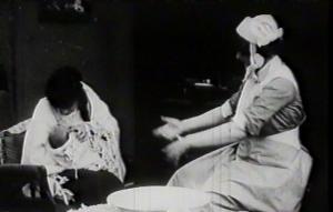 Dorothea Baird (a/w/p) teaches mother how to bathe a baby at School for Mothers in Motherhood (1917)