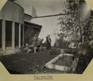 Beulah Marie Dix (w) at home w/ husband & dogs NYPL